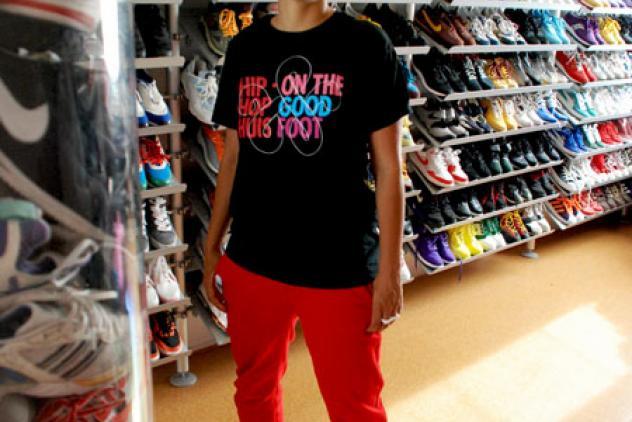 Aruna Vermeulen te midden van haar verzameling sneakers. Foto Loni Schick