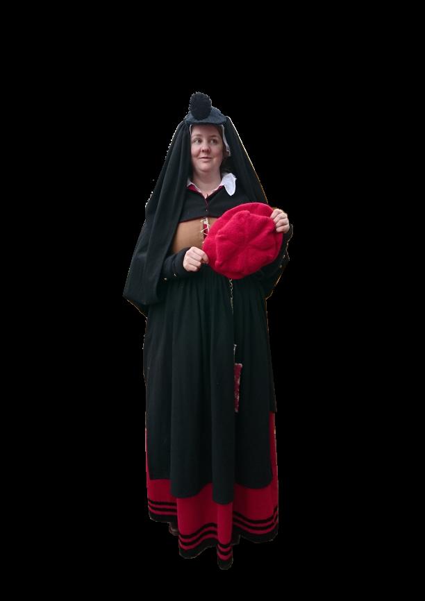 Volledige outfit bestaande uit een rijglijf, rok (waaronder een beuning wordt gedragen), jak, neerstik met aangezette kraag, colletje van wol, losse ondermouwen met sierknopen, schortekleed, huik, besteksetje en de gemaakte baret in mijn handen.