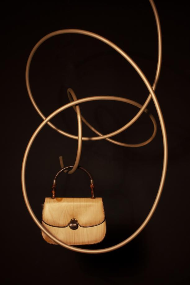 Handtas in imitatiehout van Gucci voor Ghislaine Deby, ca. 1965-1975 © Lot Doms